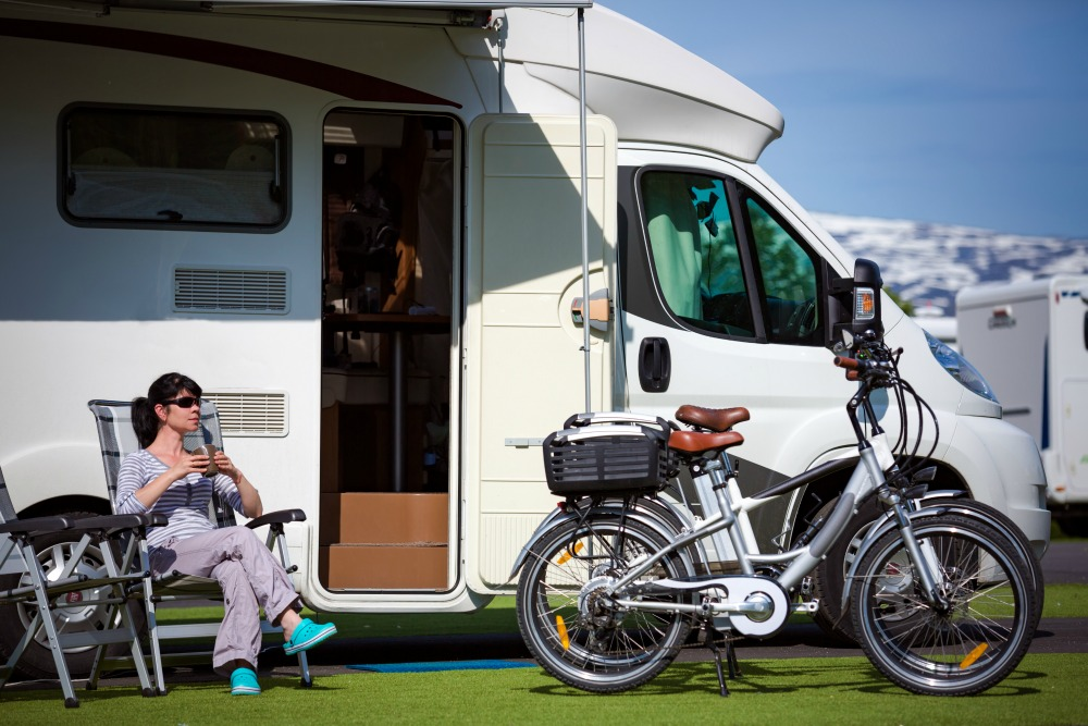 Woman-sits-outside-caravan