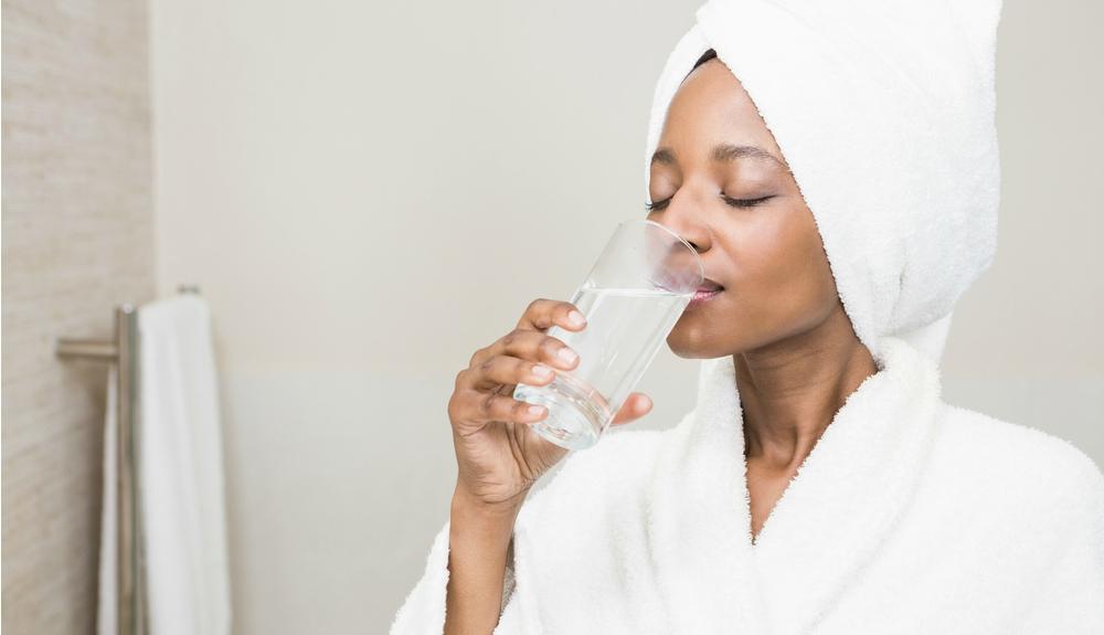 girl-drinks-water-in-bathroom