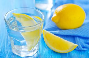 Sliced of lemon on a glass of water