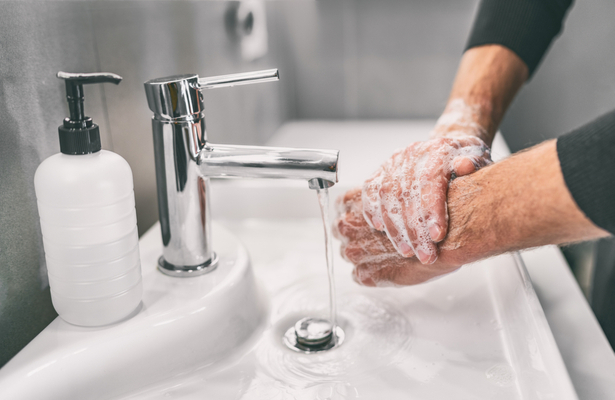 WFA - A man washing his hands with tap water