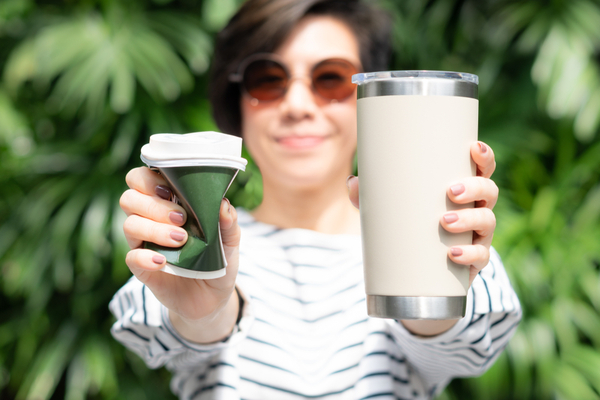WFA - Beautiful woman holding takeaway coffee cup in both hands