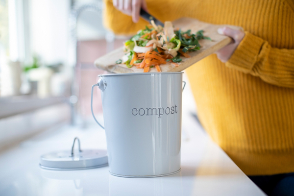 WFA - Close Up Of Woman Making Compost From Vegetable Leftovers In Kitchen