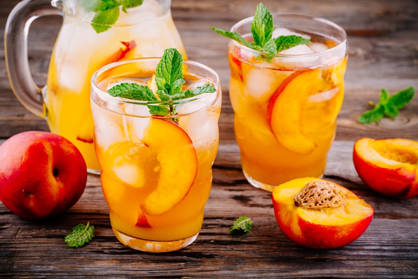 WFA - Homemade peach sangria with ice cubes, and mint in glass