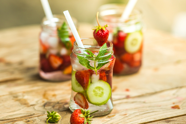 WFA - Three glass jars of lemonade with strawberries, cucumber and mint